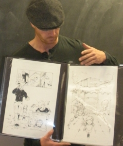 OKC artist Don Rosencrans shows off his portfolio to the classroom