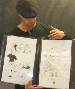 OKC artist Don Rosencrans shows off his portfolio to the classroom